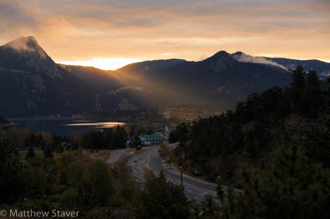 Estes Park, CO – October 4, 2015 A view a portion of Lake Estes and a portion of Estes Park at sunrise before the Elk Bugling Contest that is part of the 17th annual Elk Fest in Estes Park, Colorado, U.S., on Sunday, October 4, 2015.    Photographer:  Matthew Staver