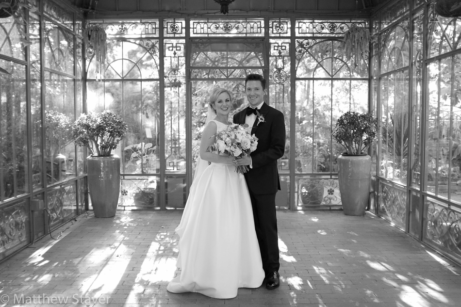 A black and white portrait of a bride and groom captured before their wedding ceremony at the Denver Botanic Gardens.