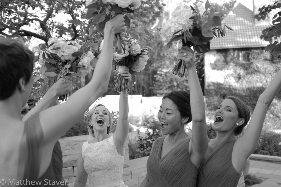 A black and white documentary photograph of the emotion of the bride before her wedding.