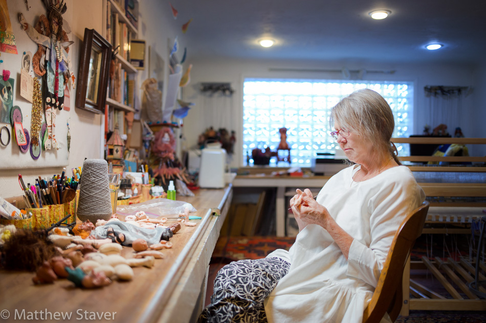 A documentary, environmental portrait of artisian, craftsman and entrepreneur in her workspace (studio and theater and workshop))